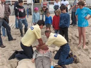 Reanimatie op strand Website